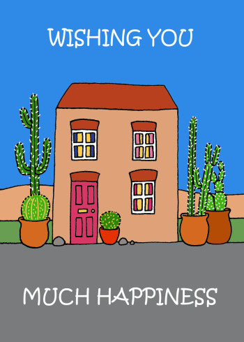 House in the desert with cacti plants.