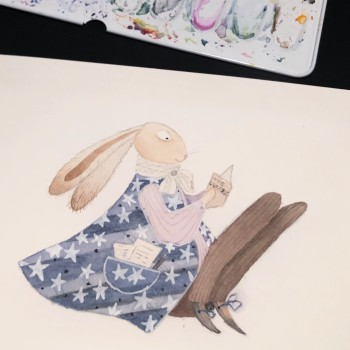 A bunny reading a book