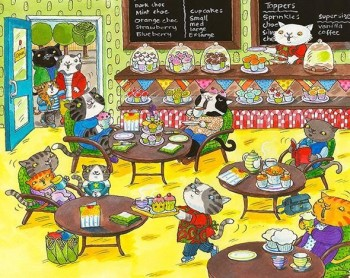 Cats eating cupcakes in the cafe.