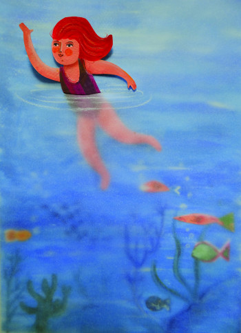 Redhaired girl swimming